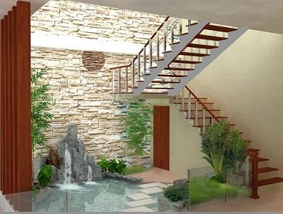 Góc chết dưới chân cầu thang trở nên thu hút nhờ hồ nước và cỏ cây trang trí